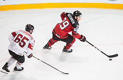 Ramon Untersander of Switzerland vs Nate Mackinnon of Canada during the 2017 IIHF Men's World Championship group B Ice hockey match between National Teams of Canada and Switzerland, on May 13, 2017 in AccorHotels Arena in Paris, France. Photo by Vid Ponikvar / Sportida