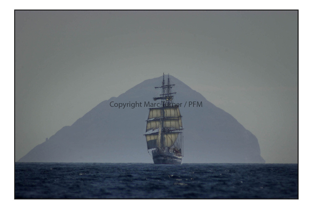 The Stavros S Niarchos of the Tall Ships Youth Trust enters the Firth of Clyde past Ailsa Craig..Marc Turner / PFM