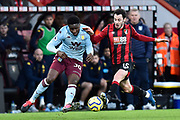 Kortney Hause (30) of Aston Villa battles for possession with Adam Smith (15) of AFC Bournemouth during the Premier League match between Bournemouth and Aston Villa at the Vitality Stadium, Bournemouth, England on 1 February 2020.