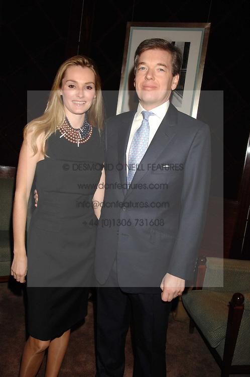 CHARLIE BUTTER and his wife AGNIESZKA at a party to celebrate the publication of Top Tips For Girls by Kate Reardon held at Claridge's, Brook Street, London on 28th January 2008.<br />