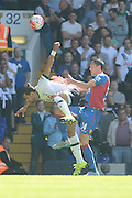 Martin Kelly beats Nacer Chadli to the header during the Barclays Premier League match between Tottenham Hotspur and Crystal Palace at White Hart Lane, London, England on 20 September 2015. Photo by Alan Franklin.