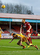 Matt Harrold of Crawley Town leaps high to win a header from a corner during the Sky Bet League 2 match between Crawley Town and Cambridge United at the Checkatrade.com Stadium, Crawley, England on 9 January 2016. Photo by Andy Walter.