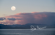 In-camera double exposure of a full moon over Aysen Fjord, Chile.