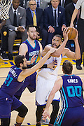 Golden State Warriors center JaVale McGee (1) attacks the basket against the Charlotte Hornets at Oracle Arena in Oakland, Calif., on February 1, 2017. (Stan Olszewski/Special to S.F. Examiner)