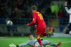 CARDIFF, WALES - Friday, October 12, 2012: Wales' Aaron Ramsey in action against Scotland's goalkeeper Allan McGregor during the Brazil 2014 FIFA World Cup Qualifying Group A match at the Cardiff City Stadium. (Pic by David Rawcliffe/Propaganda)