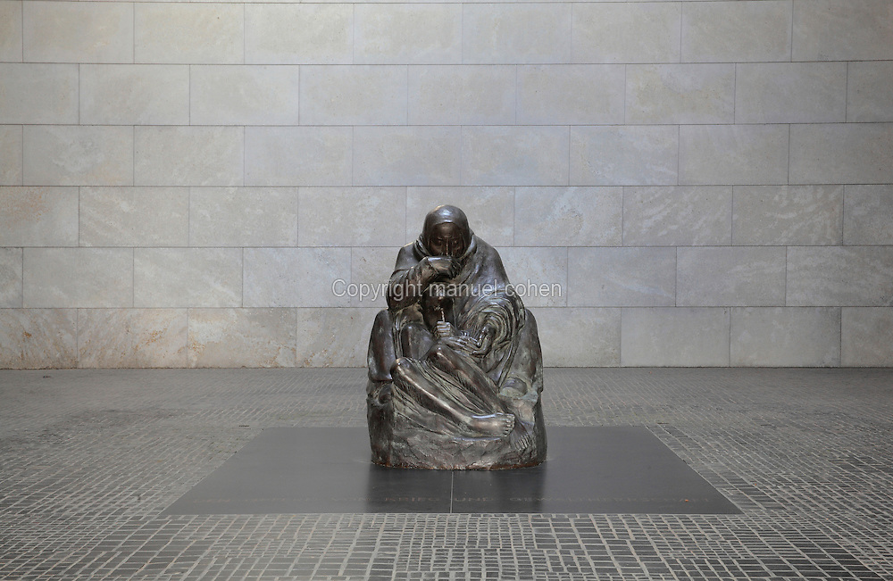 Sculpture of Mother with her Dead Son by Kathe Kollwitz, placed here in 1993, in the Neue Wache or New Guardhouse on Unter den Linden, Berlin, Germany. The sculpture sits under an oculus, exposing it to the elements and symbolising the suffering of the people during the Second World War. The building serves as the Central Memorial of the Federal Republic of Germany for the Victims of War and Dictatorship. It was originally built as a guardhouse for Prussian troops but has been a war memorial since 1931. Picture by Manuel Cohen