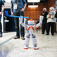 Lyon, France - 19 March 2014: NAO Robot by Aldebaran plays golf at Innorobo 2014, the 4th international trade show on service robotics.