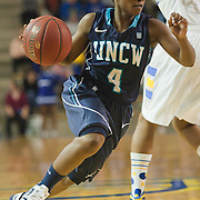 01/12/12 Newark DE: University of North Carolina Wilmington Sophomore Guard Alisha Andrews #4 drives past Delaware Forward #12 Danielle Parker during a Colonial Athletic Association Conference Basketball Game against The Fightin Blue Hens Thursday, Jan. 12, 2012 at the Bob Carpenter Center in Newark Delaware.