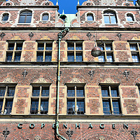 Mathias Hansen House in Copenhagen, Denmark <br /> Mathias Hansen was a politician in the early 17th century.  In 1616, he had this red brick, three-level renaissance style townhouse built.  He went on to become the borgermester or city major for four years starting in 1622.  The Mathias Hansens Gård is one of the oldest structures in the center of Copenhagen.  It is now occupied by Royal Copenhagen, the manufacturer of fine Danish porcelain.