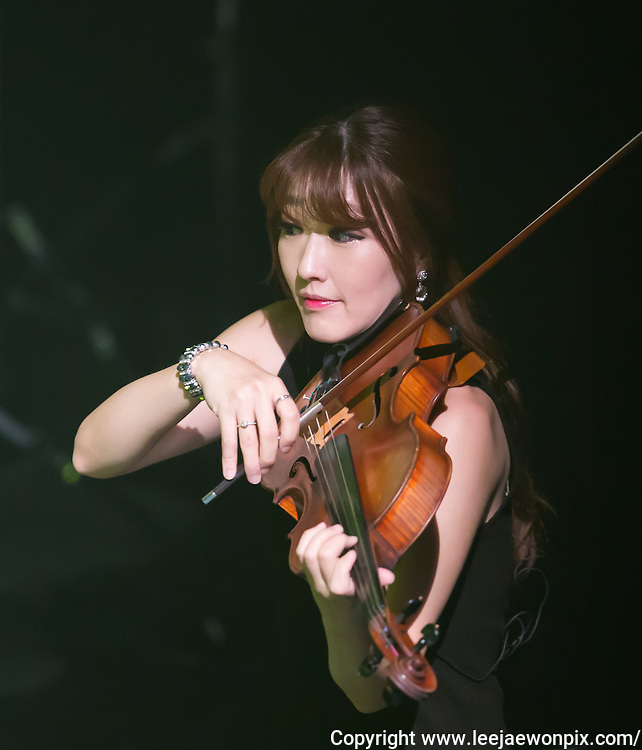 Violist MinKyung Lora Chung and South Korean singer-songwriter Baekja (not seen in photo) perform during a showcase for his third album at Seongsu art-hall in Seoul, South Korea, September 8, 2016. Photo by Lee Jae-Won (SOUTH KOREA)  www.leejaewonpix.com