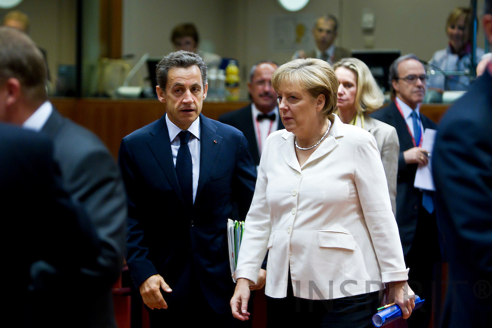 The French President Nicolas Sarkozy speaking with The German Chancellor Angela Merkel on the second day of the EU-Summit in Brussels on Friday 24 June 2011.  PHOTO: ERIK LUNTANG / INSPIRIT Photo