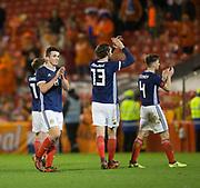 9th November 2017, Pittodrie Stadium, Aberdeen, Scotland; International Football Friendly, Scotland versus Netherlands; Scotland's John McGinn, Charlie Mulgrew and Kieran Tierney applaud the fans at the end