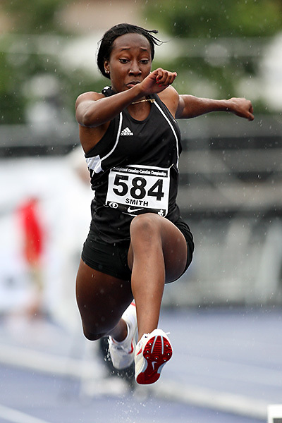 (Toronto, Ontario---28/06/09)   Alicia Smith competing in  women's triple jump final at the 2009 Canadian National Track and field Championships. Photograph copyright Sean Burges / Mundo Sport Images, 2009. www.mundosportimages.com / www.msievents.