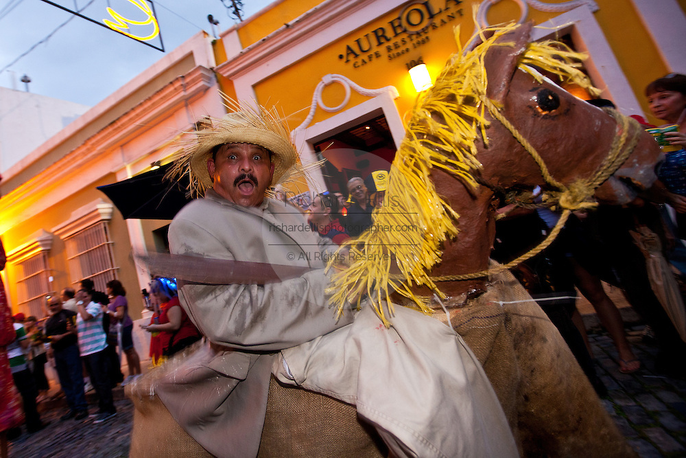 A costumed reveler during the Festival of San Sebastian in San Juan, Puerto Rico.