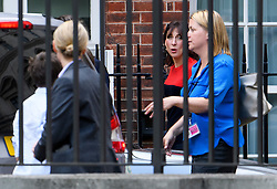 © Licensed to London News Pictures. 13/07/2016. London, SAMANTHA CAMERON appears to mouth something to her son (left) as she is seen returning to 10 Downing Street in London with her husband David Cameron (Not pictured) on his last day as British prime minister with Theresa May due to be sworn in as the new British prime minister. Photo credit: Ben Cawthra/LNP