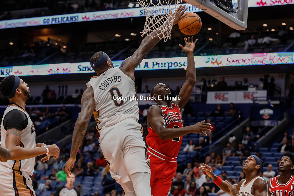 Oct 3, 2017; New Orleans, LA, USA; New Orleans Pelicans forward DeMarcus Cousins (0) blocks a shot by Chicago Bulls guard Jerian Grant (2) during the second quarter of a NBA preseason game at the Smoothie King Center. Mandatory Credit: Derick E. Hingle-USA TODAY Sports