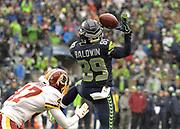 Nov 5, 2017; Seattle, WA, USA; Seattle Seahawks wide receiver Doug Baldwin (89) attempts to catch a pass as Washington Redskins cornerback Quinton Dunbar (47) defends uring an NFL football game at CenturyLink Field.