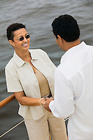 Couple Holding Hands on Boat