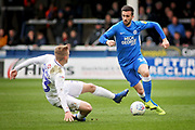 Peterborough Utd's Daniel Lafferty (18) goes round Coventry City midfielder Luke Thomas (23) during the EFL Sky Bet League 1 match between Peterborough United and Coventry City at London Road, Peterborough, England on 16 March 2019.