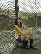 Woman Sitting On Basketball