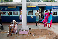 Train passengers get off to buy things and stretch their legs at Erode Junction stn., a 20 minute stop for the Himsagar Express 6318 in Tamil Nadu on 9th July 2009.. .6318 / Himsagar Express, India's longest single train journey, spanning 3720 kms, going from the mountains (Hima) to the seas (Sagar), from Jammu and Kashmir state of the Indian Himalayas to Kanyakumari, which is the southern most tip of India...Photo by Suzanne Lee / for The National