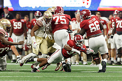 Alabama Crimson Tide running back Damien Harris (34) dives for extra yards against the Florida State Seminoles during the Chick-fil-A Kickoff NCAA football game on Saturday, September 2, 2017, in Atlanta. (Paul Abell via Abell Images for Chick-fil-A Kickoff Game)