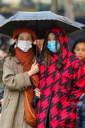 © Licensed to London News Pictures. 26/01/2020. London, UK.  Women in central London are seen wearing face masks following the outbreak of Coronavirus in China which has killed 41 people. Photo credit: Dinendra Haria/LNP