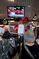 © licensed to London News Pictures. London, UK 24/04/2011. The Royal Wedding of HRH Prince William to Kate Middleton. In Poland the event is shown on screens in shops. Passers by watch through the door. Please see special instructions for usage rates. Photo credit should read Joel Goodman/LNP
