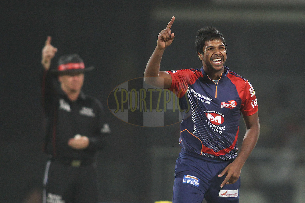 Varun Aaron of the Delhi Daredevils celebrates after getting Shaun Marsh of the Kings XI Punjab caught behind during match 64 of the the Indian Premier League (IPL) 2012  between The Delhi Daredevils and the Kings XI Punjab held at the Feroz Shah Kotla, Delhi on the 15th May 2012..Photo by Shaun Roy/IPL/SPORTZPICS