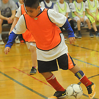 Christo Pavad-Paz controls the ball during the Wilmington Hammerheads' Youth Outreach Indoor Friendly Tournament Sunday January 11, 2015 at the MLK Center in Wilmington, N.C. (Jason A. Frizzelle)