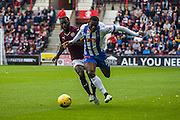 Kilmarnock FC Midfielder Tope Obadeyi gets fouled by Hearts FC Midfielder Morgaro Gomis during the Ladbrokes Scottish Premiership match between Heart of Midlothian and Kilmarnock at Tynecastle Stadium, Gorgie, Scotland on 3 October 2015. Photo by Craig McAllister.