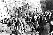 Protester standing on column, 1st Criminal Justice March, Trafalgar Square, London, UK, 1st of May 1994.