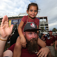 Florida State fans pose in the fan zone prior to an NCAA football game between the Ole Miss Rebels and the Florida State Seminoles at Camping World Stadium on September 5, 2016 in Orlando, Florida. (Alex Menendez via AP)