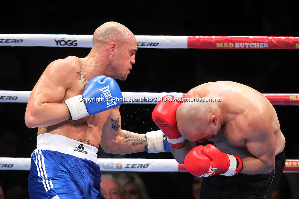 Sam Rapira in blue wins fight one in the undercard bout against Atalili Fai in red in the Hydr8 Zero Fight Night Joseph Parker v Afa Tatupu, 10 October 2013. Photo: Fiona Goodall/photosport.co.nz