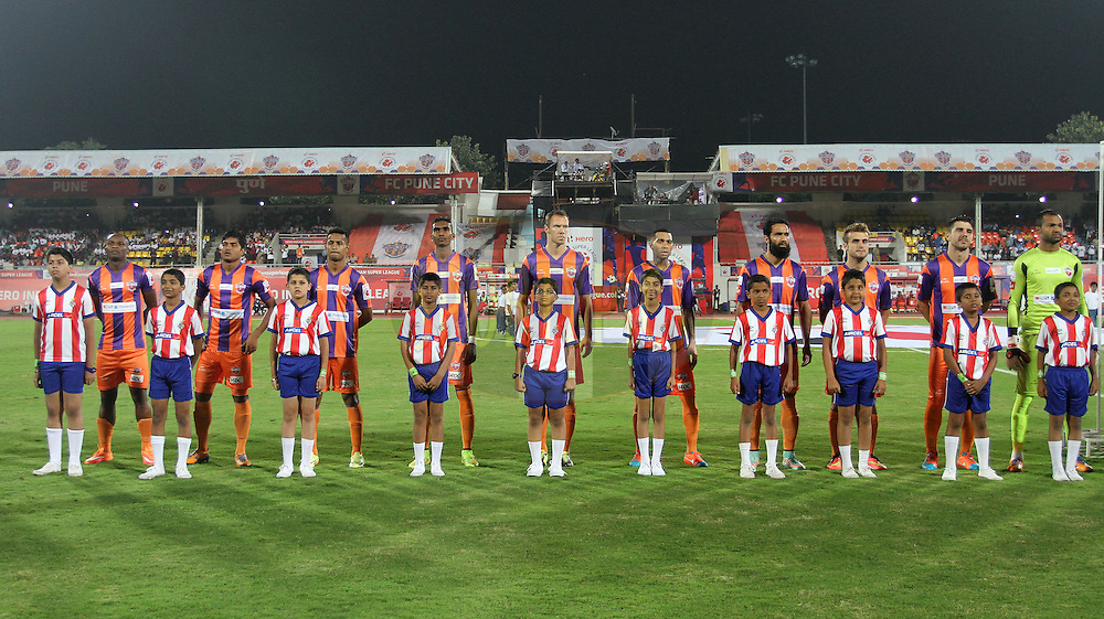 FC Pune City stand for the national anthem during match 44 of the Hero Indian Super League between FC Pune City and Atletico de Kolkata FC held at the Shree Shiv Chhatrapati Sports Complex Stadium, Pune, India on the 29th November 2014.<br /> <br /> Photo by:  Vipin Pawar/ ISL/ SPORTZPICS