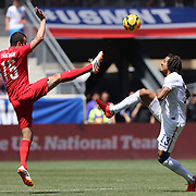 Oguzhan Ozyakup, (left), Turkey, and Jermaine Jones, USA, challenge for the ball during the US Men's National Team Vs Turkey friendly match at Red Bull Arena.  The game was part of the USA teams three-game send-off series in preparation for the 2014 FIFA World Cup in Brazil. Red Bull Arena, Harrison, New Jersey. USA. 1st June 2014. Photo Tim Clayton