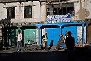 Men hang out on the main street in the bazaar in Kargil