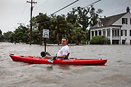 Man with his dog in the  floodwater at Mandeville's lakefront after Tropical storm Barry turned into Hurricane Barry and water pushed in from Lake Pontchartrain.