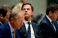 Minister van Sociale Zaken Lodewijk Asscher, Premier Mark Rutte en Minister van Financiën, Jeroen Dijsselbloem tijdens de eerste dag van de Algemene Beschouwingen in de Tweede Kamer.