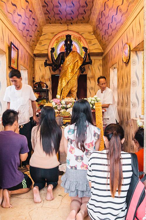 Making offerings at the Dorngkeur Shrine on Preah Sisowath Quay, Phnom Penh