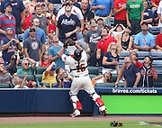 ATLANTA, GA - JULY 27:  Catcher Brian McCann #16 of the Atlanta Braves catches a foul pop fly while the fans look on during the game against the St. Louis Cardinals at Turner Field on July 27, 2013 in Atlanta, Georgia.  (Photo by Mike Zarrilli/Getty Images)