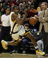 Seattle SuperSonics' Kevin Durant drives to the basket as Seattle head coach P.J. Carlesimo, right, watches from the sideline against the Toronto Raptors during the first quarter of NBA action, at Bank of America Arena, in Seattle, on Friday, Dec. 21, 2007. (AP Photo/Kevin P. Casey)