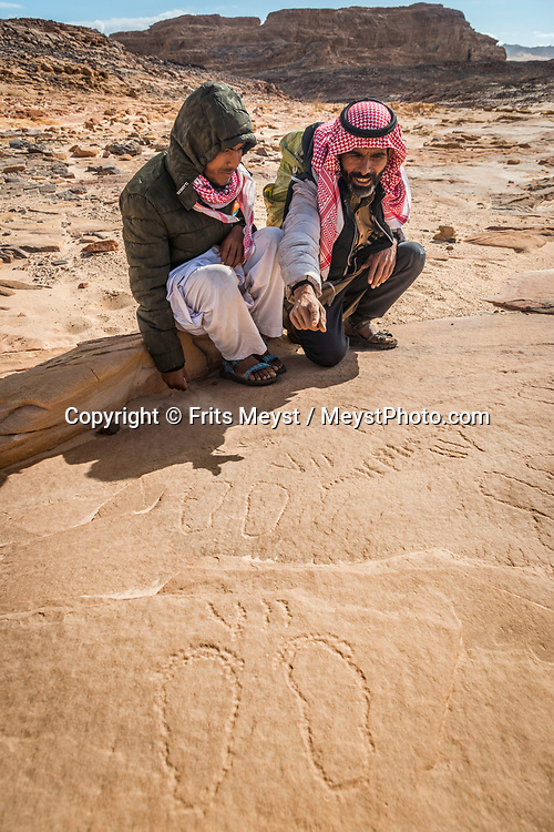 Sinai, Egypt, December 2018. Bedouin petroglyfs carvings at Naqb El Hamadat, while hiking with the Tarabin Tribe through the Sinai Desert Coastal Ranges. The Sinai Trail is Egypt's 1st long distance hiking trail, running 230km from the Gulf of Aqaba to the top of the Sinai's highest mountain. It connects old trade, travel and pilgrimage routes through one of the Middle East's most iconic desert wildernesses and is managed by a cooperative of three Bedouin tribes. Photo by Frits Meyst / MeystPhoto.com