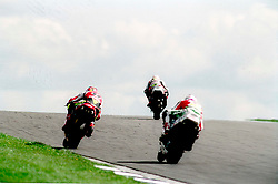 AND CHASES HIS TEAM MATE AARON SLIGHT New Zealand ON CASTROL HONDA,  TROY CORSER AUSTRALIA ON DUCATI BATTLES WITH COLIN EDWARDS USA World Superbikes Round 2 Championship Donington Park 13th April 1998