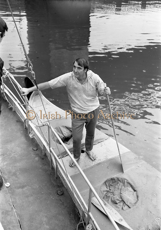 """03/08/1967<br /> 08/03/1967<br /> 03 August 1967<br /> Arrival of """"Saint Brendan II"""" in Dublin. Image shows Vint Lloyd of Nova Scotia, on board the """"Saint Brendan II"""" a curragh he and Captain Louis Lourmais hoped to sail from Fenit Co. Kerry to America by the Northern Route (Ireland, Iceland, Greenland, North America) and land between Boston and Rhode Island to see if Brendan the Navigator could have reached North America in the 6th century AD. Captain Lourmais had the curragh built to specifications resembling those of what was believed to be the type of craft available in the  6th century. It was the first time the curragh had been in the water since its construction."""