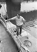 "03/08/1967<br /> 08/03/1967<br /> 03 August 1967<br /> Arrival of ""Saint Brendan II"" in Dublin. Image shows Vint Lloyd of Nova Scotia, on board the ""Saint Brendan II"" a curragh he and Captain Louis Lourmais hoped to sail from Fenit Co. Kerry to America by the Northern Route (Ireland, Iceland, Greenland, North America) and land between Boston and Rhode Island to see if Brendan the Navigator could have reached North America in the 6th century AD. Captain Lourmais had the curragh built to specifications resembling those of what was believed to be the type of craft available in the  6th century. It was the first time the curragh had been in the water since its construction."