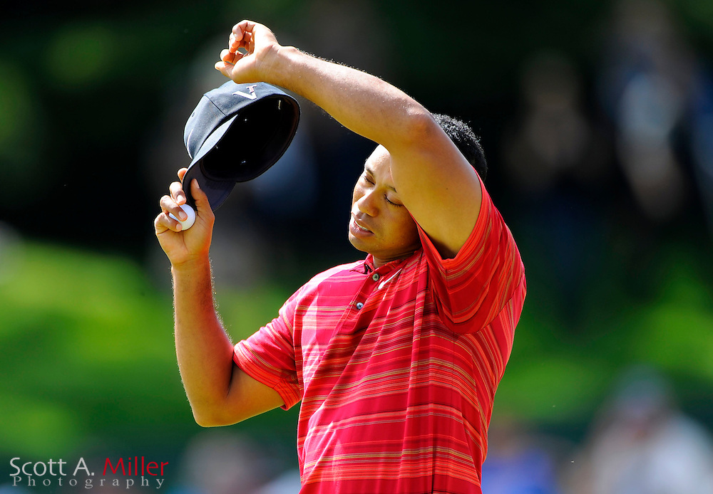 Aug 16, 2009; Chaska, MN, USA; Tiger Woods (USA) wipes his head after completing the 5th hole during the final round of the 2009 PGA Championship at Hazeltine National Golf Club.  ©2009 Scott A. Miller