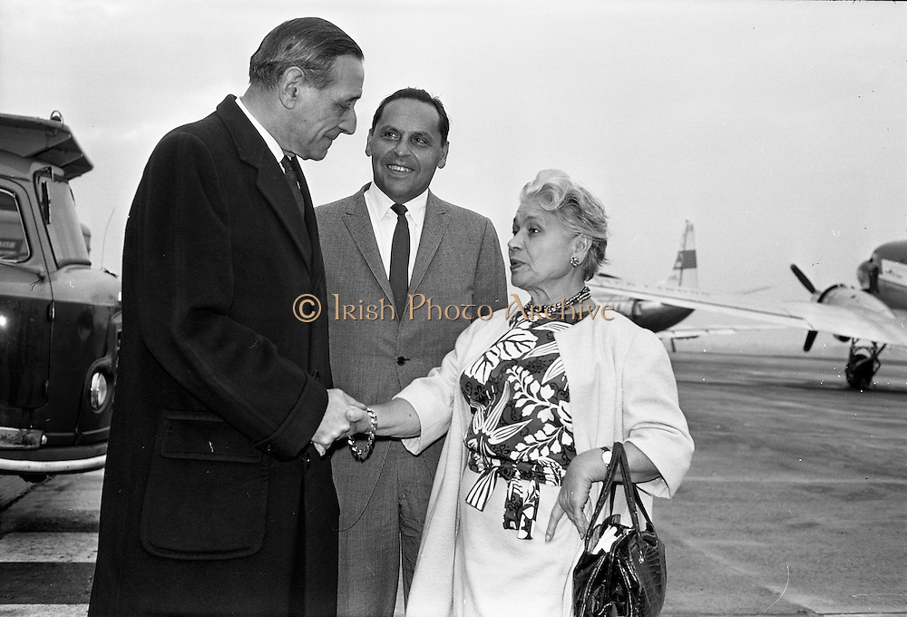 25/09/1962<br /> 09/25/1962<br /> 25 September 1962<br /> Mrs Ida Rosenthal arrives at Dublin Airport. Mrs Rosenthal, Founder and Chairman of the board of Maidenform Inc., U.S.A., arrived for a two day visit to Ireland. She would appear on Telefis Eireann; visit a number of Dublin stores and hold a reception at the Gresham Hotel to celebrate 40 years of business. Picture shows Mr Robert Briscoe TD (left) greeting Mrs Rosenthal on her arrival. In centre is Mr Sol Rubenstein, Assistant Vice-President of International Sales, Maidenform Incorporated.