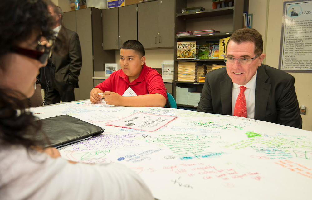 Houston ISD superintendent Dr. Terry Grier, right, talks with students during a Broad Foundation research team tour Ortiz Middle School, May 29, 2013.