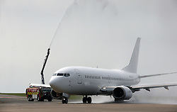 CARDIFF, WALES - Saturday, June 4, 2016: The Wales team plane is given a water-cannon send off by the Cardiff Airport Fire Brigade as the squad head to Sweden for their last friendly before the UEFA Euro 2016 in France. (Pic by Michael Hall/Cardiff Airport/Propaganda)